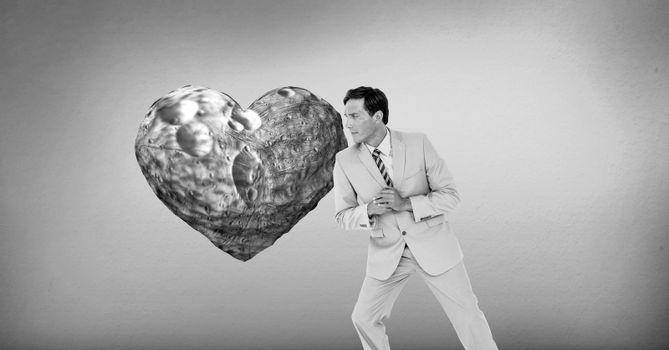 Businessman leaning against surreal heart