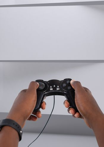 Hands holding gaming controller
