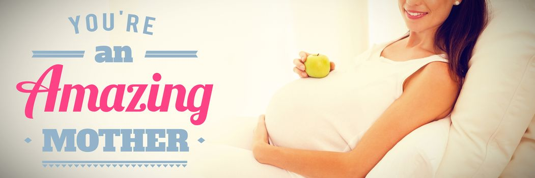 mothers day greeting against happy pregnancy with an apple on his belly