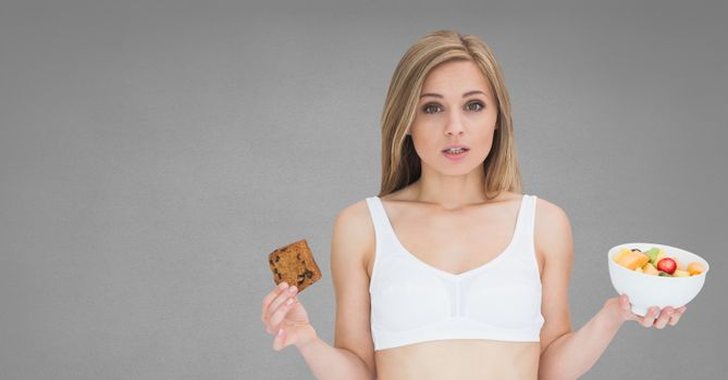 Woman holding deciding healthy and unhealthy food choice