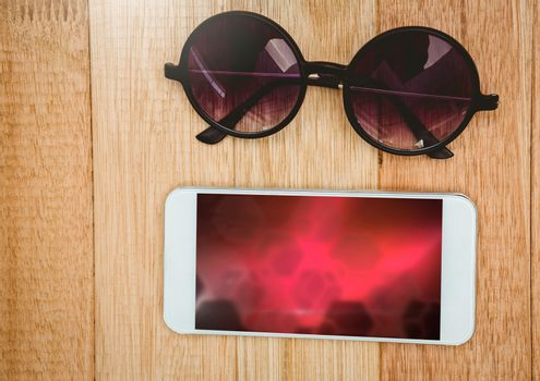 Phone with red gradient and sunglasses