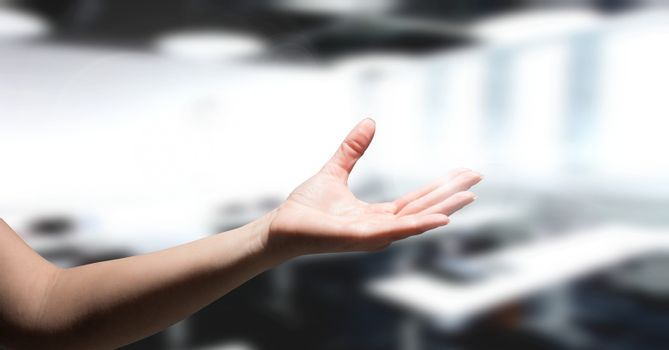 hand reaching in classroom