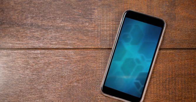 blue gradient phone on wood