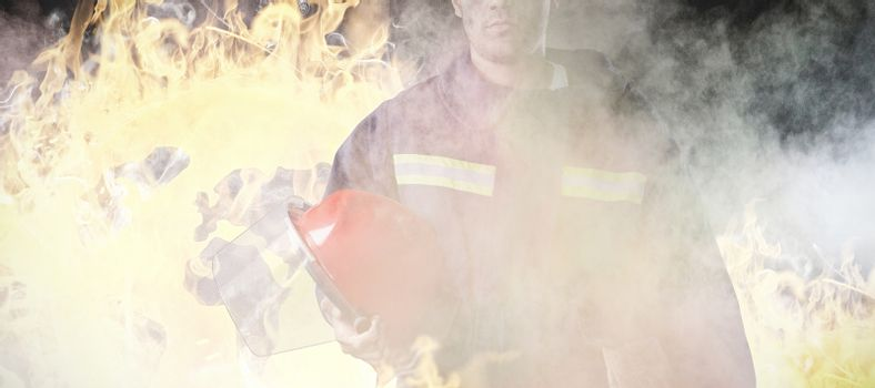 Composite image of serious fireman