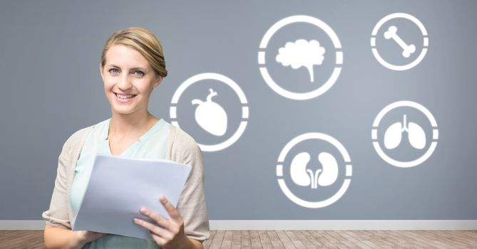 human body icons on wall and woman holding folders