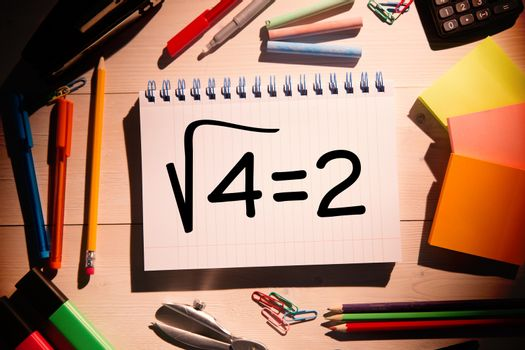 Composite image of square root of four on notepad
