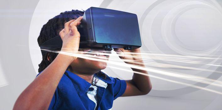 Boy wearing virtual reality simulator