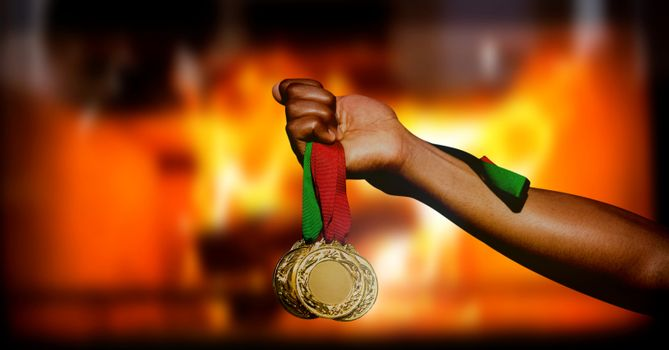 Champion sports medal and burning fire