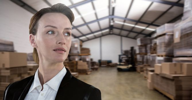 Businesswoman in warehouse perspective