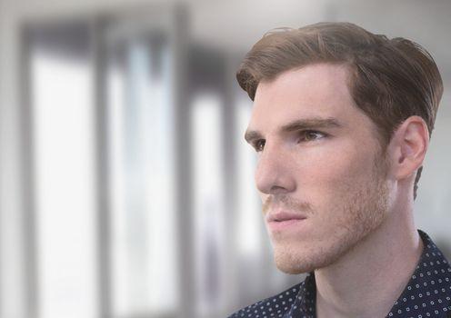 Man looking determined by window