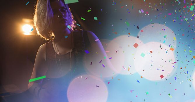 Woman at concert with confetti