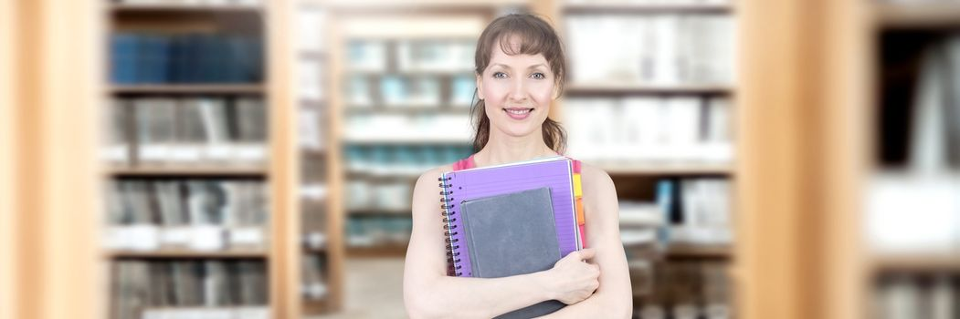 Digital composite of Student mature woman in education library