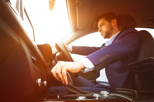 Well dressed man drives