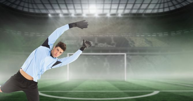 Soccer goalkeeper jumping with goal