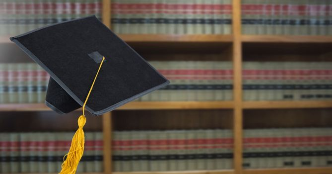 Digital composite of Graduation hat in education library