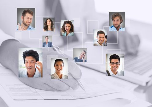 Composite image of businessperson writing with portraits picture
