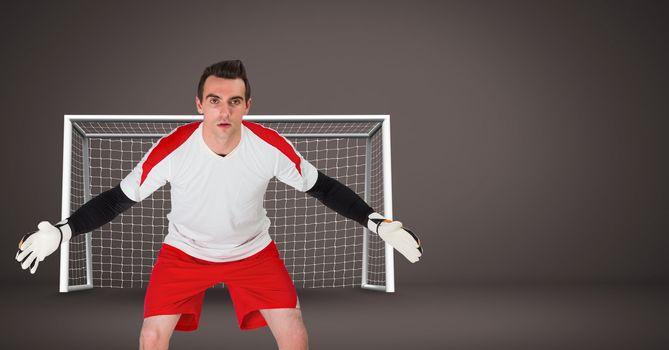 Soccer goalkeeper saving in goal