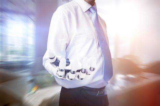 Composite image of midsection of businessman with robotic hand