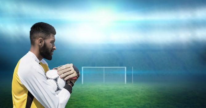 Soccer goalkeeper holding football