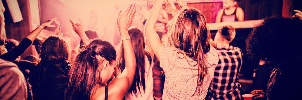 People enjoying music in nightclub