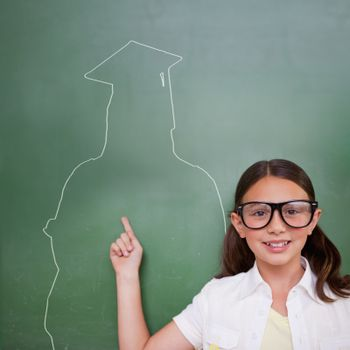 Composite image of cute pupil with graduate outline in classroom