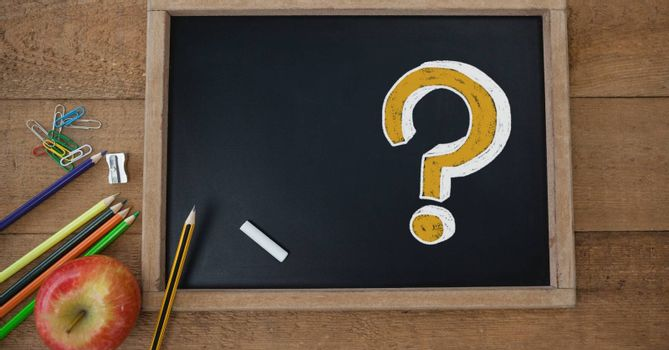Digital composite of Question Mark on education blackboard