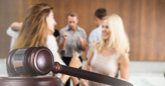 Digital composite of Gavel and people in courtroom