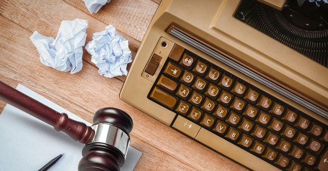 Gavel on desk with typewriter