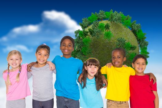 Elementary pupils smiling against bright blue sky with clouds with globe