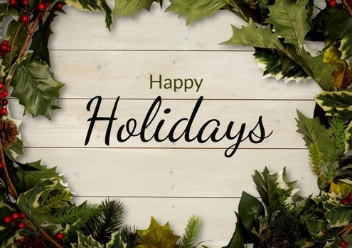 Happy holidays text with holly wreath