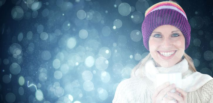 Composite image of glowing woman wearing a white pullover and a colourful hat against white backgrou