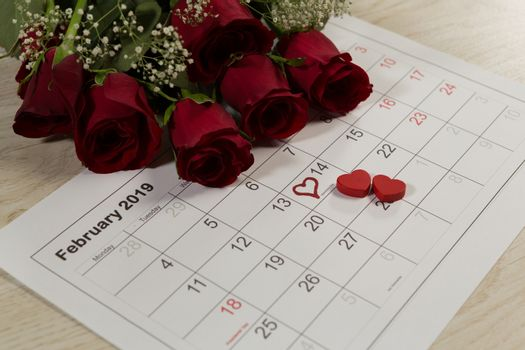 Rose bouquet with heart shape decorations on February calendar