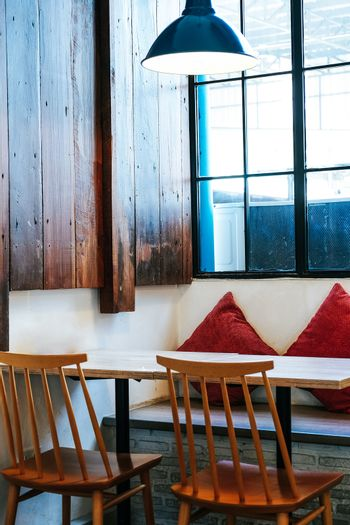 Cafe seating area with wooden table and chairs