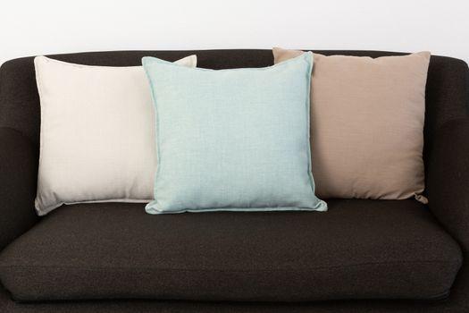 Cushions arranged on sofa