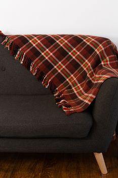 Blanket arranged on sofa