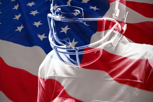 American flag with stars and stripes against american football player standing with rugby helmat