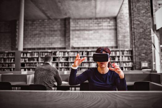 Woman gesturing while using virtual reality simulator