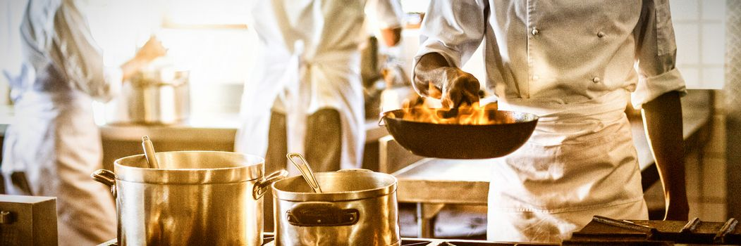 Chef cooking in commercial kitchen