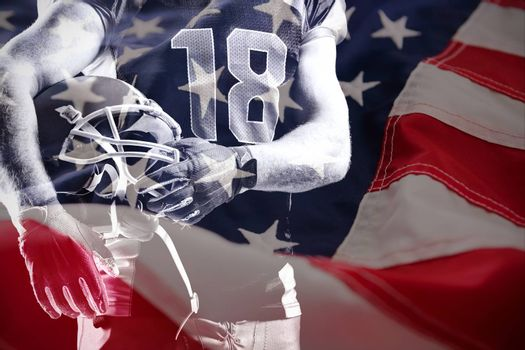 Close-up of American flag against american football player holding rugby helmet