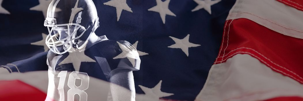 Close-up of American flag against american football player in helmet standing against black background