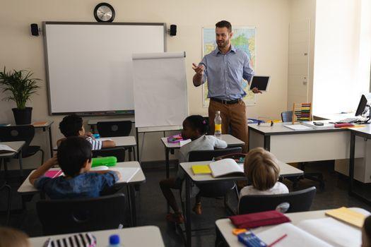 School teacher teaching in a classroom