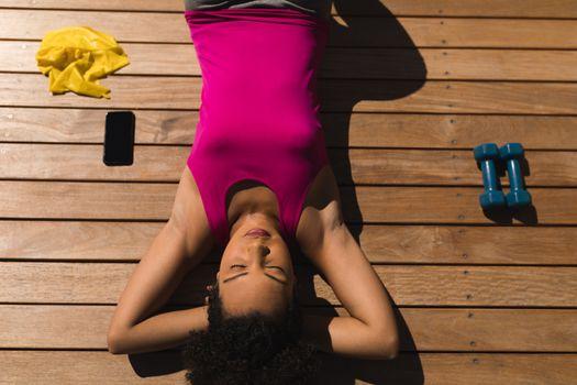 Woman relaxing in the backyard of home