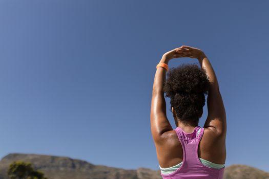 Woman performing yoga in the backyard