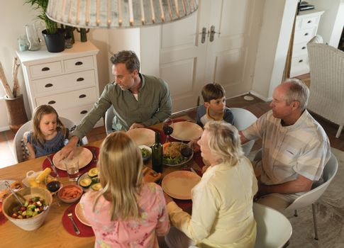Family interacting with each other while having meal