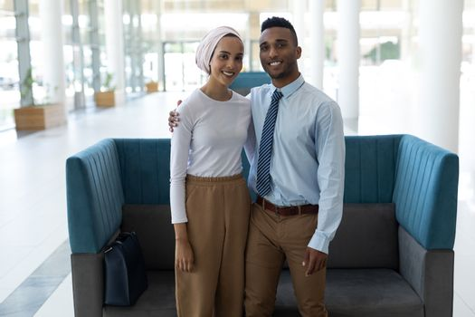 Young mixed-race couple standing together in the lobby