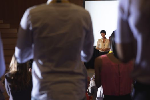 Audience clapped for the businesswoman after finishing the presentation