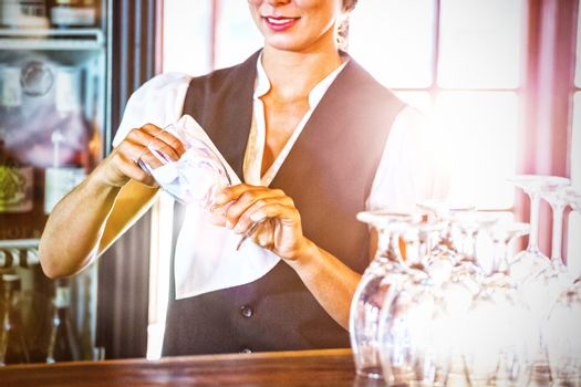 Waitress cleaning glasses
