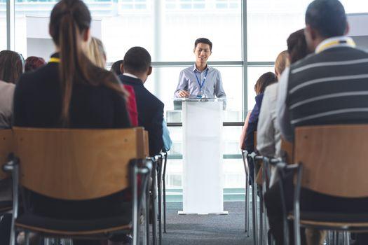 Businessman speaks in a business seminar