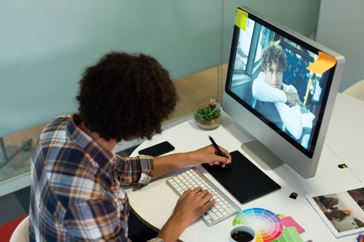 Male graphic designer using graphic tablet