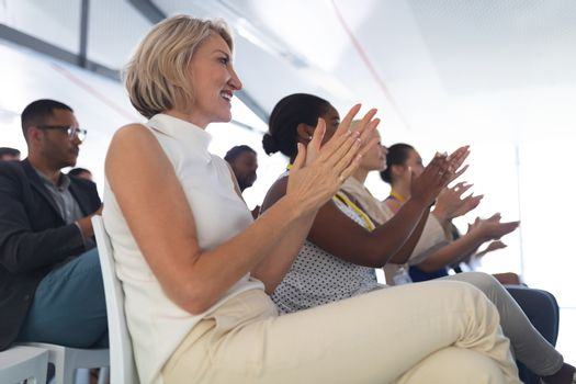 Audience applauding in a business seminar